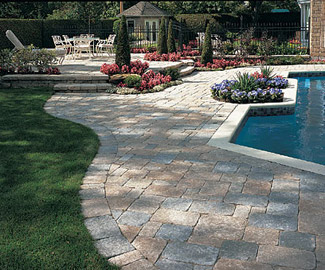 Stone Patio Design Ideas circular patio design using colored stones surrounded by pavers of stained concrete to create the illusion of a stream bubbling through the center Heres A Paver Patio Design Using Two Contrasting Colors And Four Different Sizes