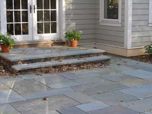 In This Photo, You Can Clearly See The Porch That Was Created. It Is Wide  And Comfortable To Step Out Onto. The Entire Porch And The Steps Are  Bluestone.