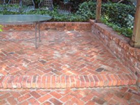 herringbone pattern set in concrete here are some photos of brick patio ideas - Patio Brick Designs