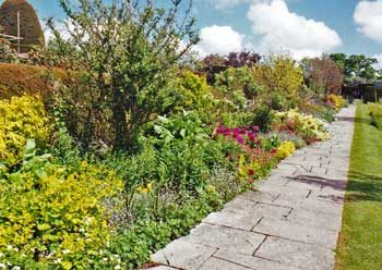 English garden design has lots of color and flowers.