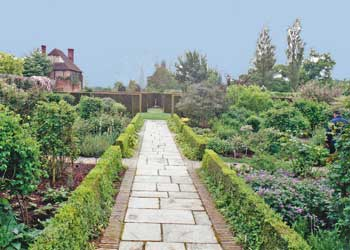 English garden design has straight lines and loose flowers.