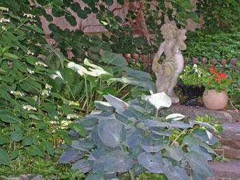 Sculptures make a nice focal point in the garden.