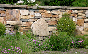 Stone garden walls types of stone the stones are interesting shapes true but i love how larger boulders are set in the wall this not only makes it interesting but breaks workwithnaturefo