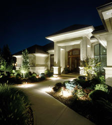 Outdoor house lighting lighting shows off the residence.