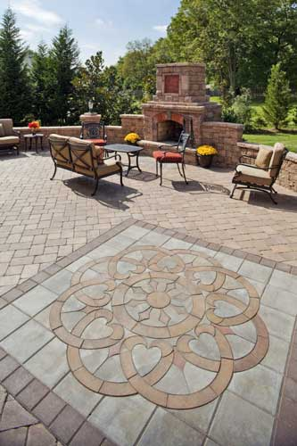 there is also something call paverart here an actual patio paver design like artwork can be inserted into the patio design - Paver Patio Design Ideas