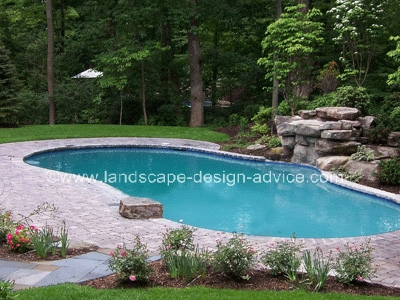 Paver pool decking and waterfall.