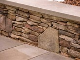 stone retaining wall with boulder
