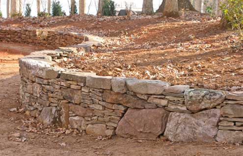 Stone Retaining Wall With Individual Stones As Top Coping