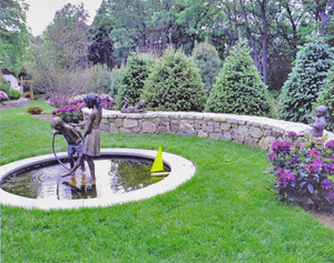 A fountain near a lovely hardscape wall