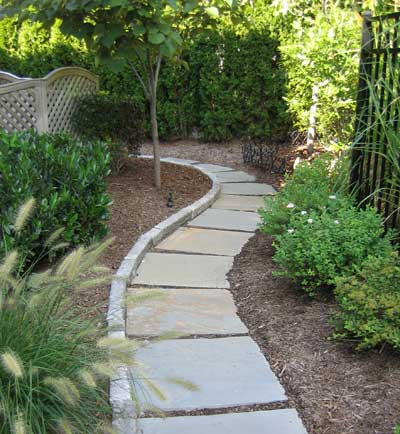 Inexpensive stone walkways and types for Landscaping ideas stone path