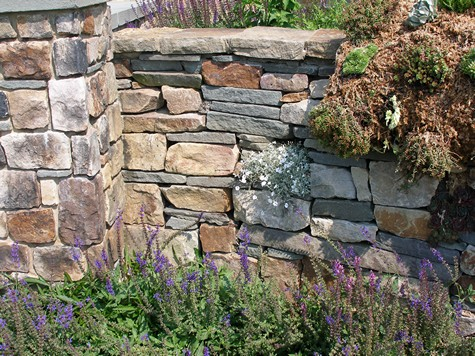 Rustic stone retaining wall.