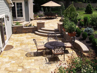 For This Two Level Patio, A Golden Color Was Used And Is Lovely. Block  Walls Were Used For The Retaining Walls And Blend Well With The Travertine.