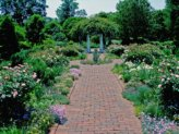 English gardens with brick walkway.