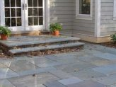 Patio and landing made of bluestone.