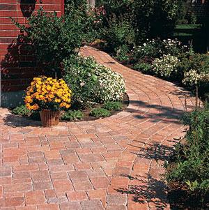 Brick colored pavers.