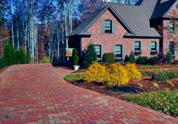 A multi-colored brick driveway.
