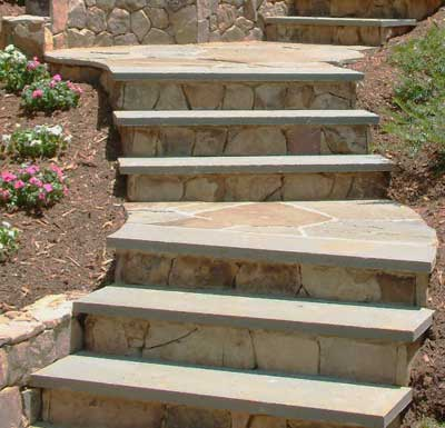 Bluestone steps set in concrete.