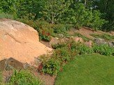 using boulders for walls and landscaping