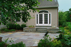 Bluestone patio with natural stone landing.