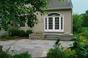 Bluestone patio with natural stone landing.