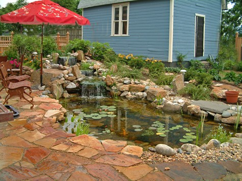 Ponds at patios can be bordered with boulders.