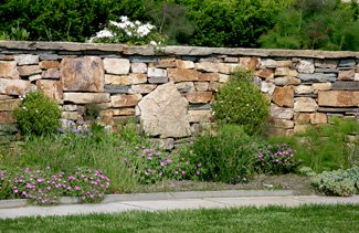 Natural stone wall with boulders.
