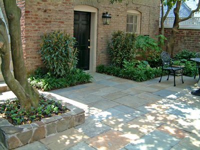 Patterned bluestone patio which is dry laid.