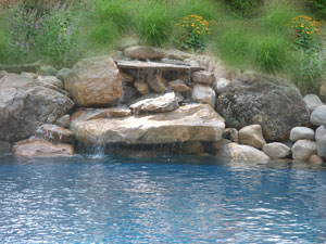Natural stone waterfall at pool.