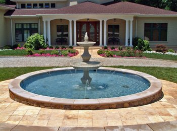 Travertine pavers color should blend with the house.
